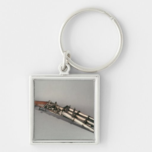 Triple-barrelled pistol keychains