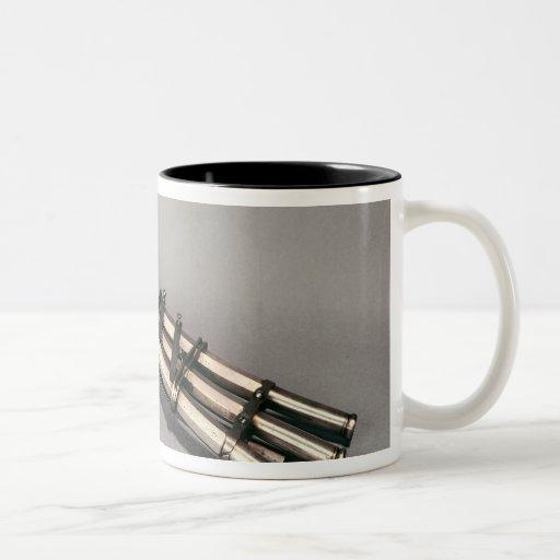 Triple-barrelled pistol coffee mugs