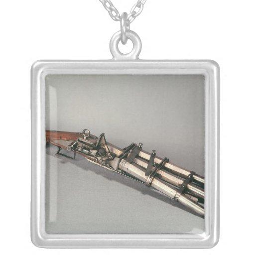 Triple-barrelled pistol necklaces