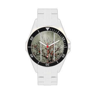 Tríptico con motivo natural reloj