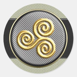 Triskele de oro pegatina redonda