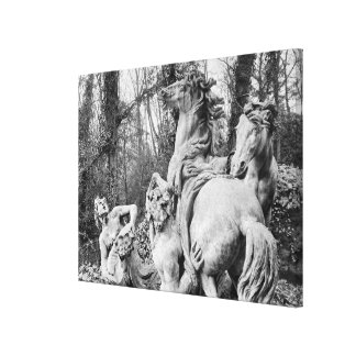 Tritons grooming two horses of the sun canvas print