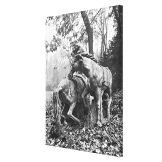 Tritons grooming two horses of the sun in canvas print