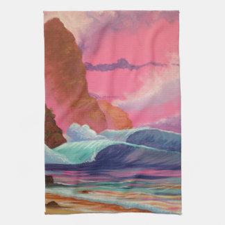 Trituradores en la puesta del sol toallas