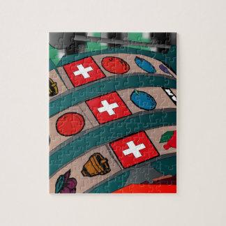 Triunfo del suizo de la máquina tragaperras - casi puzzles