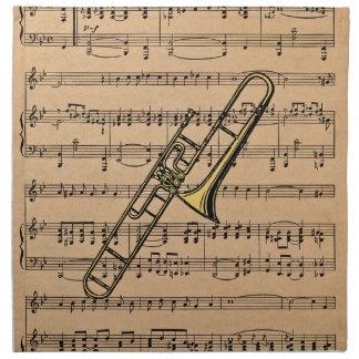 Trombone con el fondo de la partitura servilletas