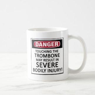 Trombone del peligro taza de café