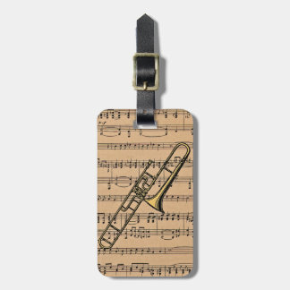 Trombone With Sheet Music Background Bag Tags
