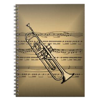 Trompeta con el fondo de la partitura notebook