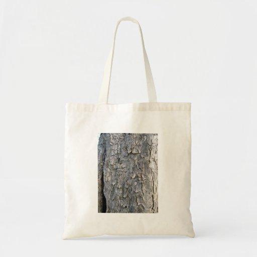 Tronco de árbol de madera gris gastado bolsas