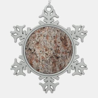 Tronco de árbol imperecedero adorno de peltre en forma de copo de nieve
