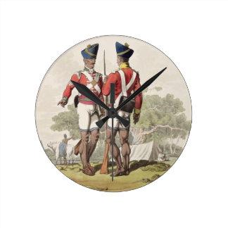 Tropas nativas en el servicio de la compañía del e reloj de pared