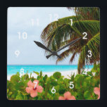 "Tropical Beach Hibiscus Palm Tree Wall Clock<br><div class=""desc"">This design features a photo of a tropical beach - white sand,  blue waters,  palm branches,  hibiscus flowers and its surrounding foliage.</div>"