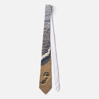 Tropical beach with footprints tie