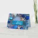 """Tropical Coastal Seashell Holiday Christmas Card<br><div class=""""desc"""">Christmas by the Sea! Add this stunning coastal-inspired greeting card to your tropical-themed holidays. The photo image on the greeting card features starfish, striped fish, seahorse, clam shells, coral, and ornamental balls in various shades of silver, blue, and white. The plaque on the wreath reads """"Seas"""