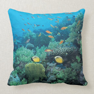 Tropical fish swimming over reef throw pillow