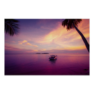 Tropical island in the sunset with a boat poster