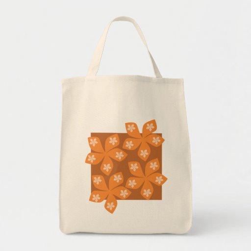 Tropical orange flowers on white. tote bag