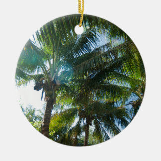 Tropical palms lit by the sun ceramic ornament