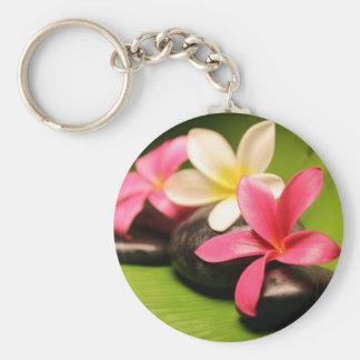 tropical plumeria flowers on stones keychain