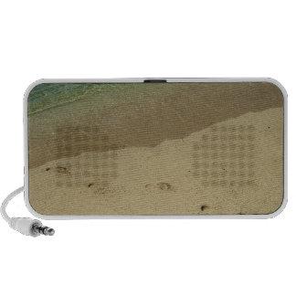 Tropical sandy beach with footprints travel speaker