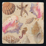 """Tropical Seashells Conch Starfish Stone Coaster<br><div class=""""desc"""">Tropical seashells stone coaster.  An array of sea life in brown and pink make an interesting addition to a coastal themed home.  Spotted junonia shells,  a lions paw,  sea horse,  queen conchs and more are featured on your choice of marble,  travertine,  marble or sandstone.</div>"""
