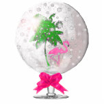 "Tropical Snow globe Ornament<br><div class=""desc"">Our original tropical snow globe artwork, with a flamingo and palm tree inside a glass snow globe. Wonderful as an ornament for your Christmas tree this year, makes an outstanding gift too. Get it as a key chain, standing sculpture, pin, and magnet too, you chose how you want this great...</div>"
