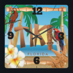 """Tropical Tiki Design Square Wall Clock<br><div class=""""desc"""">Wall Clocks. Sunrise Life is a Beach Design. This stylish wall clock will add interest and appeal to your home or tiki bar. Look for matching items. Made with high resolution vector and digital graphics for a professional print. NOTE: (All zazzle product designs are &quot;prints&quot; unless otherwise stated under &quot;About...</div>"""