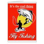 Trucha de cogida del pescador de la mosca con el c tarjetas