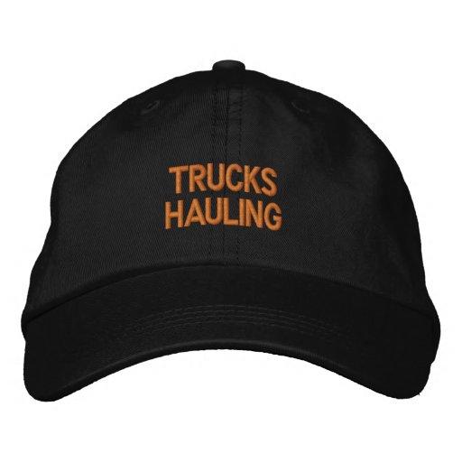 TRUCKS HAULING EMBROIDERED BASEBALL CAPS