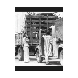 Trucks were jammed high with suitcases, blankets, canvas print
