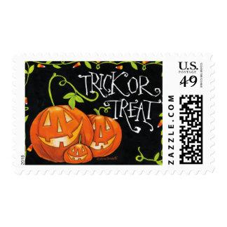 Truco de Halloween o calabaza y pastillas de Franqueo