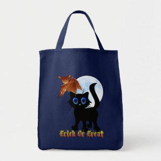 Truco o bolsos negros del gatito y del palo de la  bolsa tela para la compra