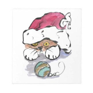 Trudy está ocultando en el gorra de Santa Blocs De Notas