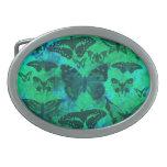 Trullo bonito y mariposas verdes hebilla de cinturón oval