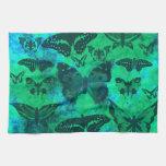 Trullo bonito y mariposas verdes toalla de cocina