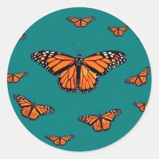 Trullo de la migración de las mariposas de monarca etiqueta redonda