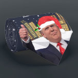 "Trump Make Christmas Great Again Holiday Neck Tie<br><div class=""desc"">This men&#39;s regular neck tie is the perfect gift for your favorite Deplorable guy this Holiday Season. Featuring President Donald J. Trump sporting a jaunty Santa Hat, standing in front of the Big City in a snowstorm, with the slogan MAKE CHRISTMAS GREAT AGAIN! We have lots of items with this...</div>"