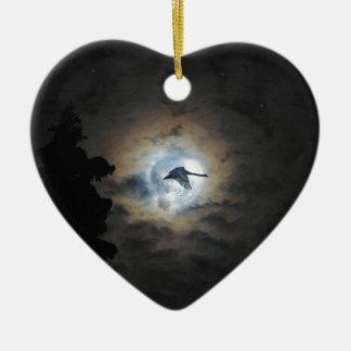 Trumpeter Swan Flying under a Full Winter Moon Ceramic Ornament