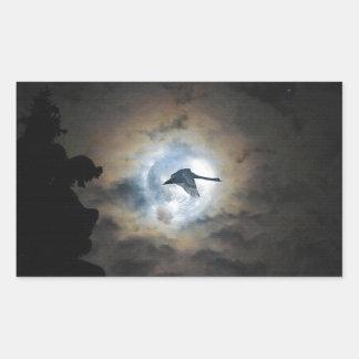 Trumpeter Swan Flying under a Full Winter Moon Rectangular Sticker