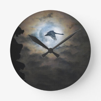 Trumpeter Swan Flying under a Full Winter Moon Round Clock