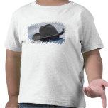 Tucson, Arizona. Gorras de vaquero funcionando en Camisetas