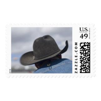 Tucson, Arizona. Gorras de vaquero funcionando en Franqueo