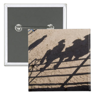 Tucson, Arizona: Shadows of Rodeo competitors Button