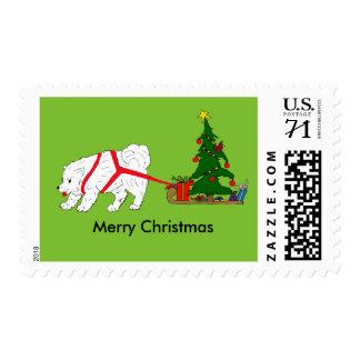 Tug the Samoyed pulling Christmas Tree Postage