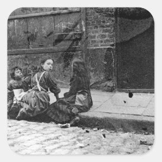 Tugurios de Londres, corte de la guita Calcomanía Cuadradas