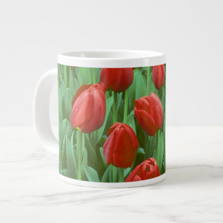 Tulip field blooms in the spring. giant coffee mug