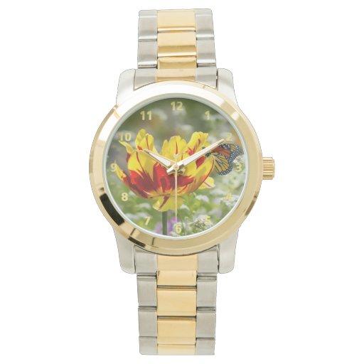 Tulipán y mariposa rojos y amarillos reloj