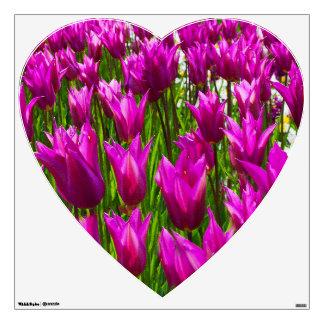 Tulipanes púrpuras en Keukenhof, etiqueta de la pa