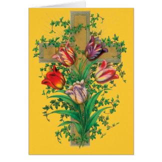 Tulipanes y cruz del navidad tarjeta de felicitación